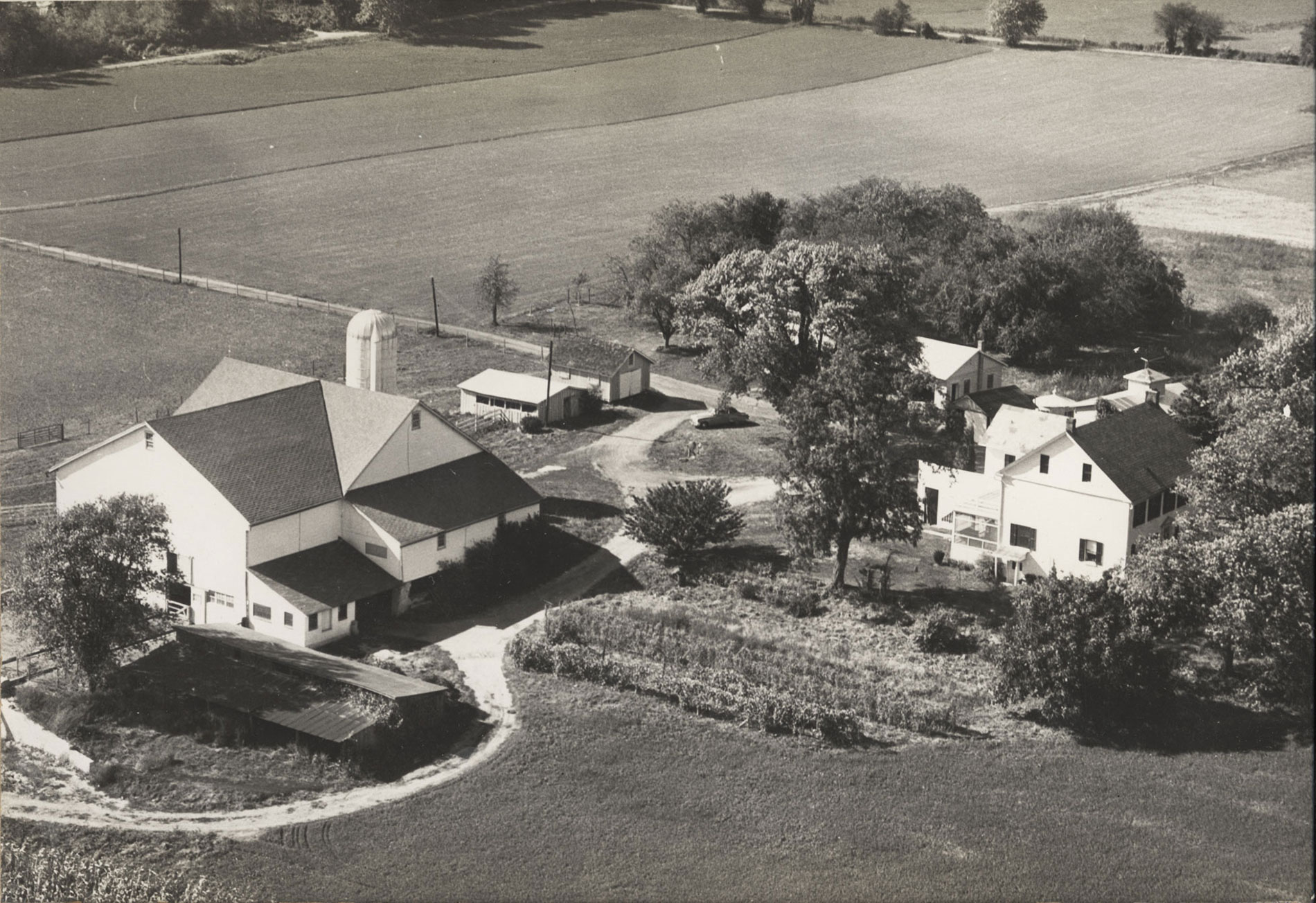 Old black and white aerial photo of the Mother Earth Farm